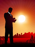 businessman at work on sunset background