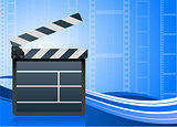 Film clapper board on blue background