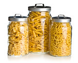 various raw pasta in glass jar