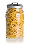 raw penne pasta in glass jar