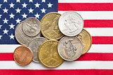 U.S. coins on American Flag