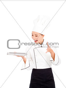 amazing cook woman chef holding tray and showing something