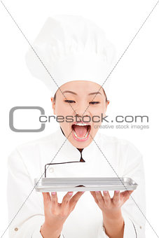 beautiful woman chef screaming and holding tray