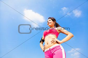Beautiful Woman ready to start workout with music