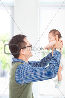 Happy father hug his smiling son at home