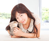 pretty woman smiling and hug her cat