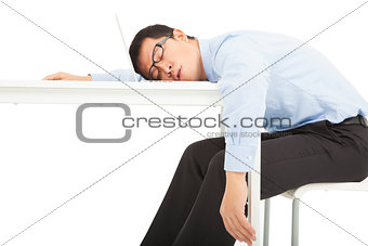 Tired overworked businessman sleeps on desk