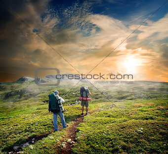 Backpackers in mountains