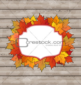 Autumn label with leaves maple, wooden texture