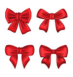 Set red gift bows isolated on white background