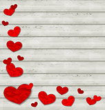 Set crumpled paper hearts on wooden background