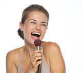 Happy young woman singing in brush