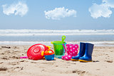 Colorful plastic children's toys on the beach