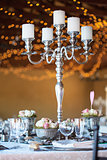 Candelabra & flowers on table at wedding reception