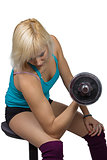 Athletic girl making exercises with dumbbell