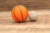 Toy sport balls on wood background