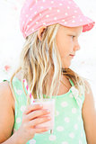 Young girl holding smoothie drink