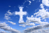 religious cross on cloudy sky