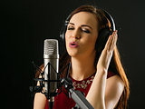Singing into a studio microphone