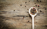 Wooden spoon with pepper
