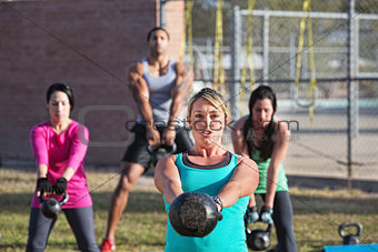 Fit Men and Women Exercising Outdoors