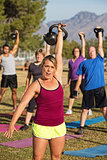 Woman Leading Strength Training Class