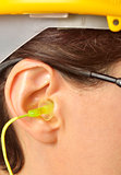 yellow earplug into the ear