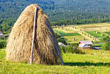 Summer mountain rural view with haystacks (Carpathian, Ukraine)