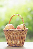 gala apples in the basket on old table
