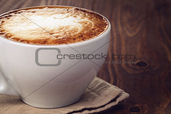 cappuccino on old wood table