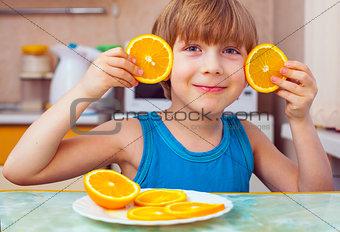 boy, breakfast, eats orange