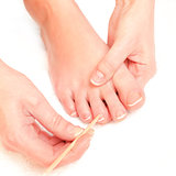 woman pushing cuticles toes