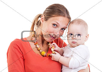 Young Caucasian woman and baby boy playing with nursing necklace over white