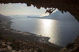 Family rock climber against picturesque view of Telendos Island at sunset. Kalymnos Island, Greece.