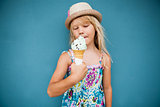 Young girl holding ice cream