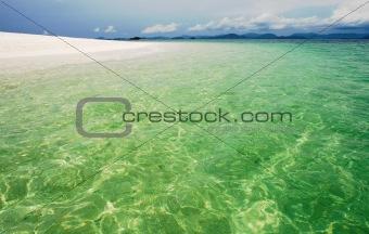 Deserted tropical beach with blue sky