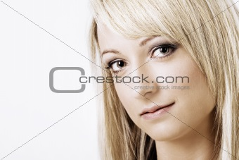Attractive young blond woman smiling