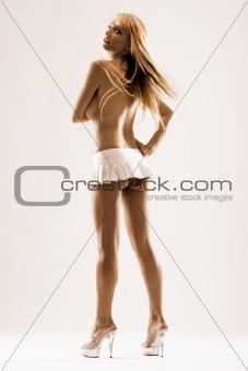 Tall blond female in white skirt