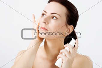 Natural beauty applying lotion