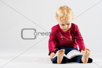 Cute girl reading the book