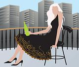 Lady sitting in a lawn and drinking wine