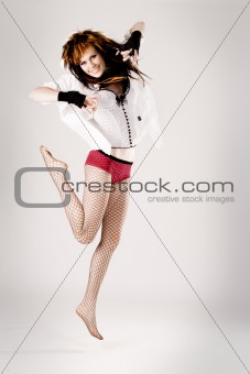 Young beautiful woman jumping
