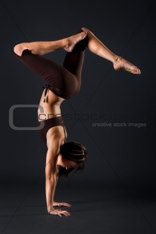 Female gymnast stretching