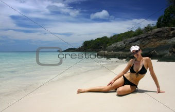 Girl in black bikini on a tropical beach