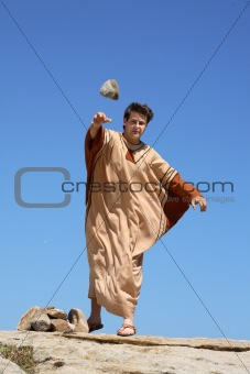 Ancient man throwing stone