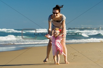 Young family with daughter on the beach