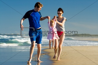 Young family carying the child