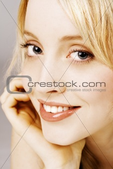 Portrait of beautiful smiling young female