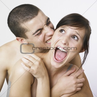 Young couple goofing around
