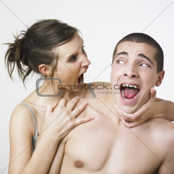 Young couple making faces
